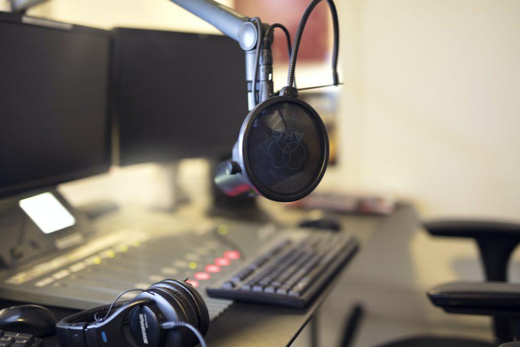 Microphone in radio station broadcasting studio in the morning